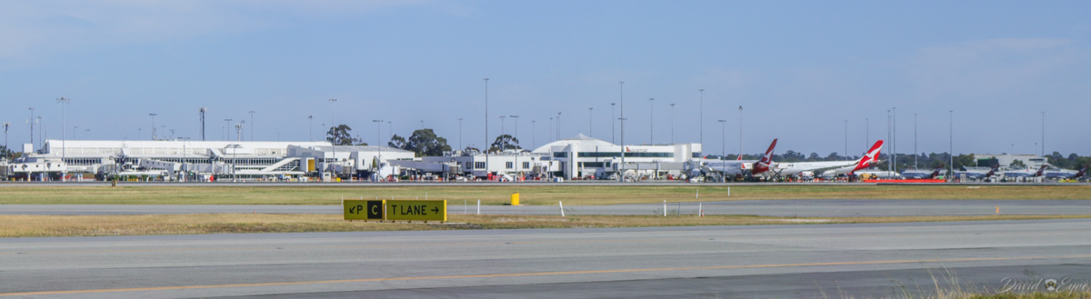 Terminals 3 and 4 at Perth Airport - 3 November 2017. Taken from the Terminal 2 apron, with VH-ZNA Boeing 787-9 at bay 14 and VH-EBJ Airbus A330-202 at Bay 12 at Terminal 4. Photo © David Eyre