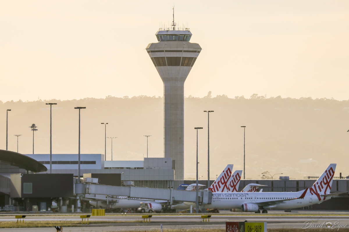 Control Tower and Terminal 1 Domestic at Perth Airport - 3 November 2017. Photo taken at 6:32am. Visible is VH-YID Boeing 737-8FE (MSN 38709/3851) of Virgin Australia, with Virgin Samoa titles, named 'Tapu'itea'. The Virgin Samoa livery was removed not long after this photo. Photo © David Eyre