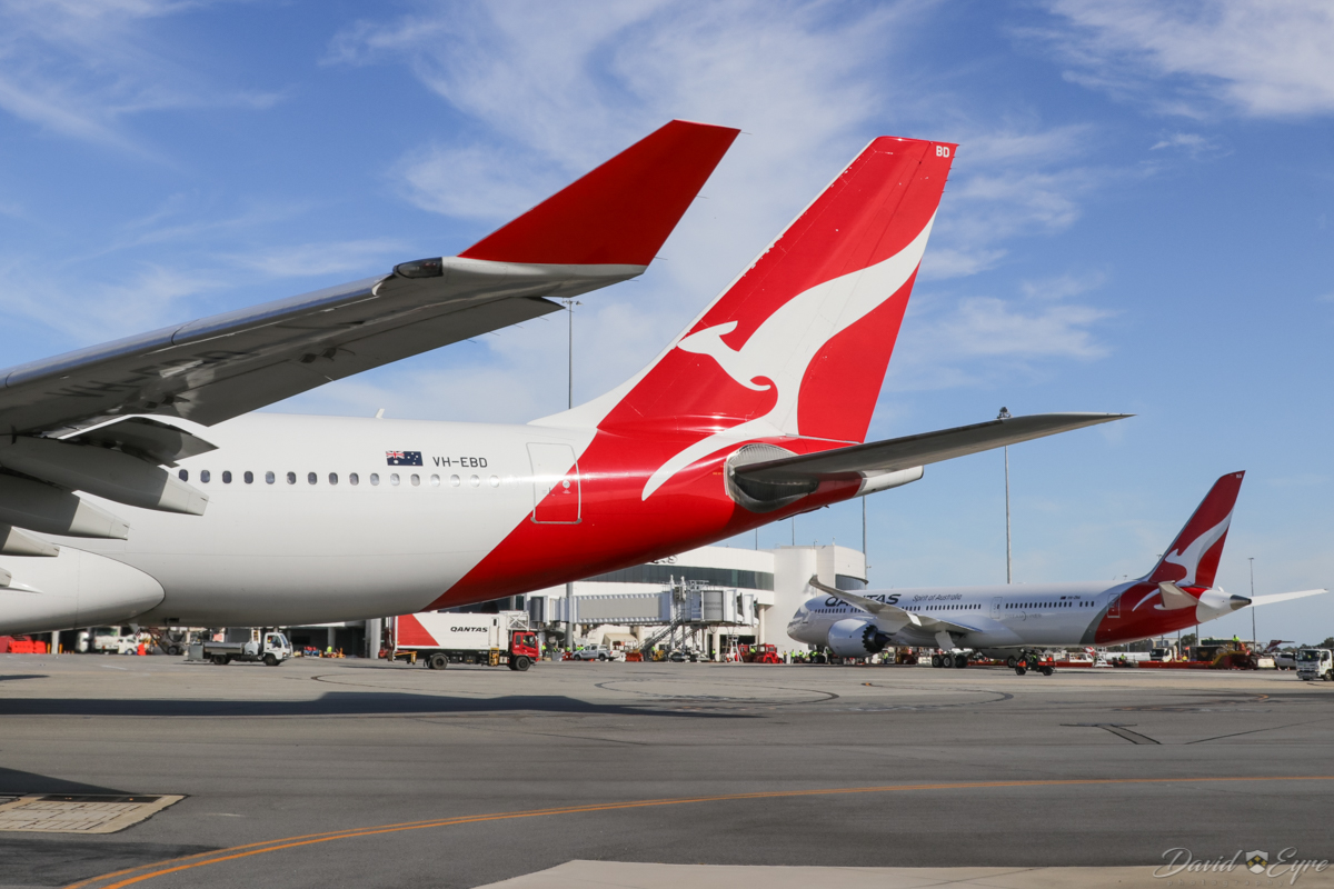 VH-EBD Airbus A330-202 (MSN 513) of Qantas, named 'Traralgon', and VH-ZNA Boeing 787-9 Dreamliner (MSN 39038/615) of Qantas, named 'Great Southern Land', at Perth Airport - 3 November 2017. VH-EBD is taxying out as flight QF762 to Melbourne, at 8:10am. VH-ZNA was on its second visit to Perth. Photo © David Eyre