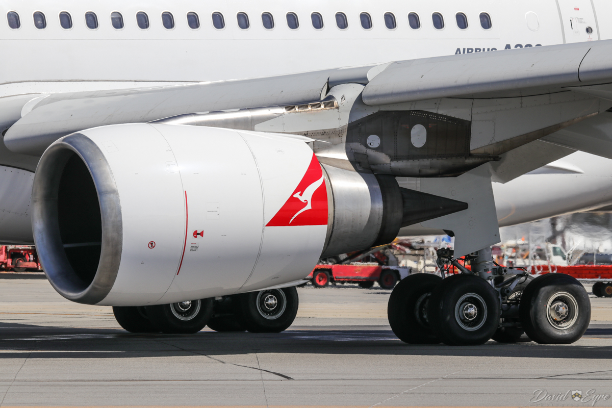 VH-EBJ Airbus A330-202 (MSN 940) of Qantas, named 'Margaret River', at Perth Airport - 3 November 2017. Close-up of the General Electric CF6-80E1A4 engine and main landing gear. Flight QF642 to Sydney, taxying out to runway 03 at 9:31am. Photo © David Eyre.