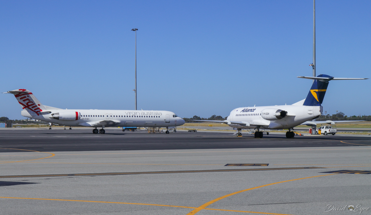VH-FWI Fokker 100 (MSN 11318) of Virgin Australia Regional Airlines, and VH-QQW Fokker 70 (MSN 11569) of Alliance Airlines, at Perth Airport - 3 November 2017. Parked on Terminal 2 apron. Photo © David Eyre