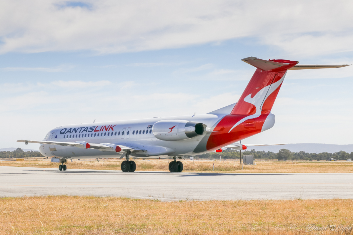 VH-NHF Fokker 100 (MSN 11458) of QantasLink (Network Aviation), at Perth Airport - 3 November 2017. NETLINK 2613 arriving from Degrussa, taxying north along taxiway A at 9:15am. Photo © David Eyre