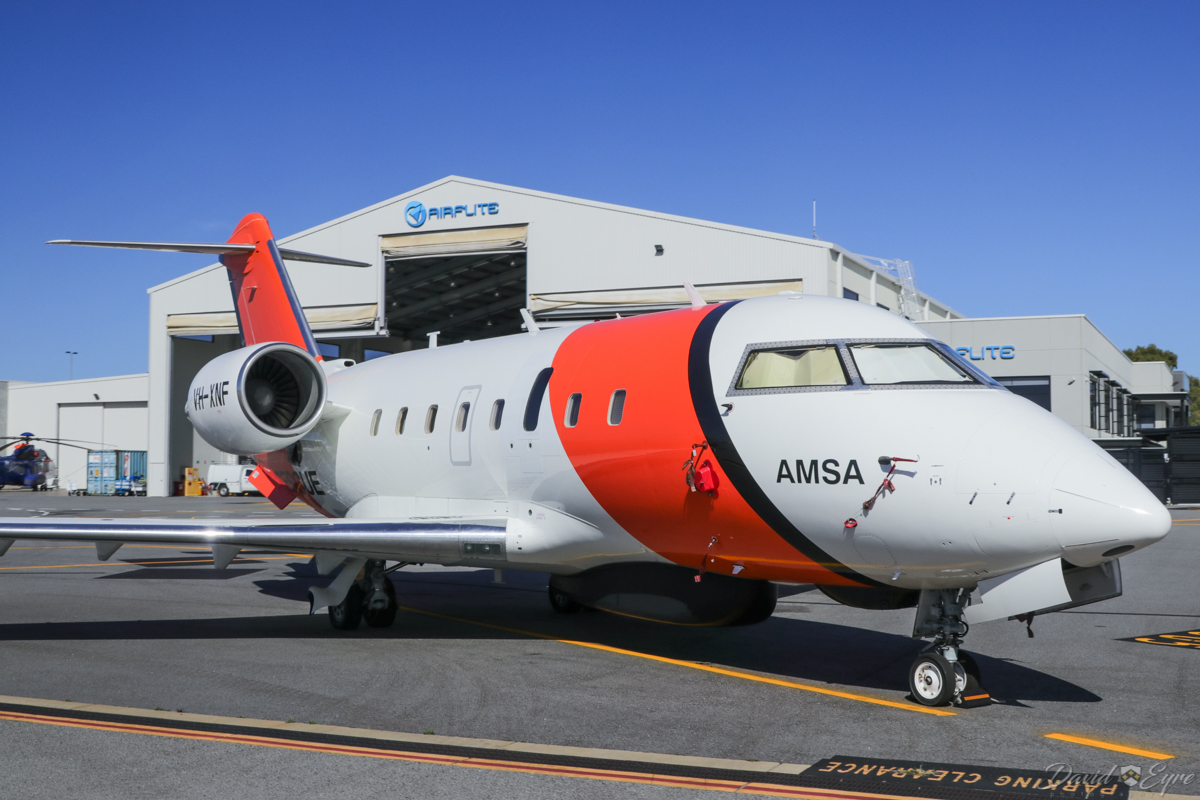 VH-XNF Bombardier CL-600-2B16 Challenger 604 (MSN 5656) owned by Cobham SAR Services Pty Ltd, operated for the Australian Maritime Safety Authority (AMSA), at Perth Airport - 3 November 2017. Parked opposite Airflite's hangar near taxiway R. The long radome under the forward fuselage is a multi mode search radar, whilst the smaller fairing just in front of it contains a search and rescue direction finder. Built in 2006, ex C-FOGX, N338FX, C-FIXN, C-GLXY. Photo © David Eyre