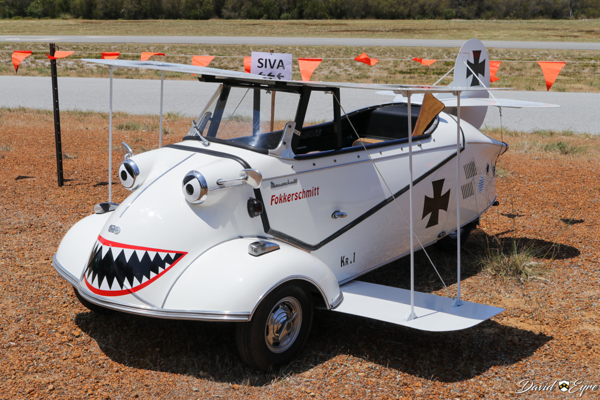 """A Messerschmitt KR201 Roadster modified to resemble a World War One German biplane, at the Sport Aircraft Builders Club (SABC) Annual Fly-In, Serpentine Airfield - 5 November 2017. Photo © David Eyre. Following the end of World War Two, Messerschmitt aircraft company was temporarily not allowed to manufacture aircraft, so began making other products. In 1952, Messerschmitt's Regensburg aircraft factory began manufacturing small motor vehicles, based on the Fend Flitzer invalid carriage. The first was the KR175 (KR stood for Kabinenroller - """"scooter with cabin""""). The KR200 replaced the KR175 in 1955. In 1956, a year after West Germany joined NATO, Messerschmitt was allowed to manufacture aircraft again, so it sold the Regensburg works to Fend who formed Fahrzeug- und Maschinenbau GmbH Regensburg (FMR) to continue production of the KR200 and KR201 - this example is an FMR-built KR201. Production of these cars ended in 1964."""