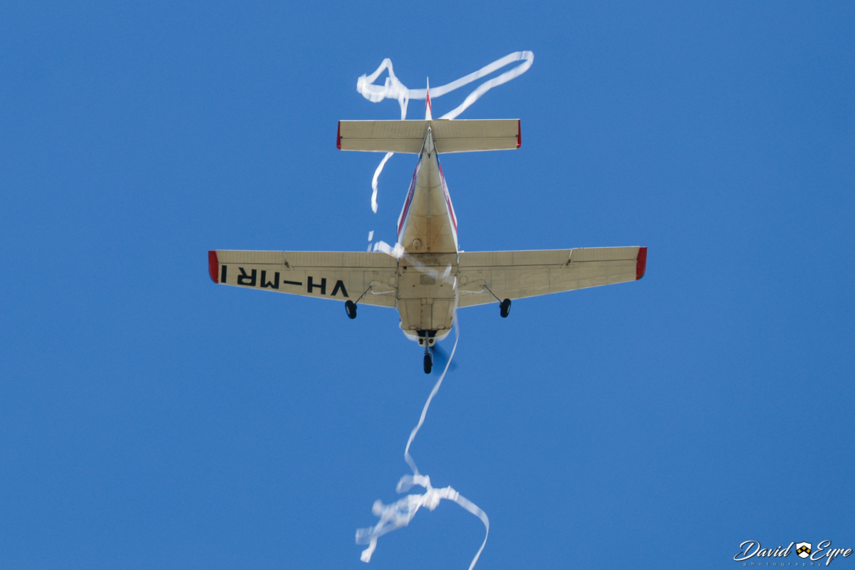 VH-MRI Victa Airtourer 115 (MSN 158) owned and flown by Sue Clarke, at Sport Aircraft Builders Club (SABC) Annual Fly-In, Serpentine Airfield - 5 November 2017. Photo © David Eyre. Cutting a streamer dropped from the aircraft. VH-MRI was built in Australia in 1965.