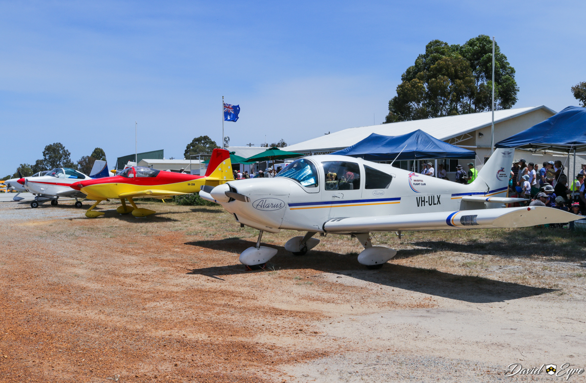 Line-up of aircraft in front of the club house at the Sport Aircraft Builders Club (SABC) Annual Fly-In, Serpentine Airfield - 5 November 2017. Photo © David Eyre. VH-MRI Victa Airtourer 115 (MSN 158) owned and flown by Sue Clarke; VH-ZDB Vans RV-7A (MSN 70471) owned by David Watkins; VH-ULX AMD Alarus CH2000 (MSN 20-1024) owned by Inverted Pty Ltd.