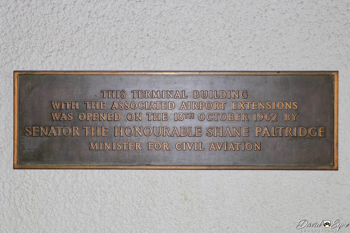 Official opening plaque on the wall outside the original 1962 terminal building, which now forms part of Terminal 3 at Perth Airport - 24 November 2017. Photo © David Eyre. The airport was upgraded in 1962, as Perth hosted the 1962 British Empire and Commonwealth Games, from 22 November to 1 December 1962. The building received a new frontage during the 1980s, but some parts of the old building are still visible, including this plaque.